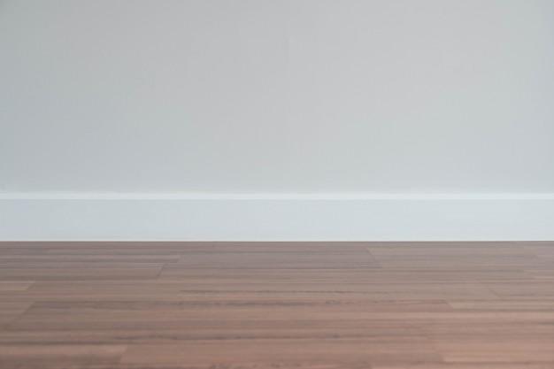 empty-wall-with-wooden-floor_1339-4849